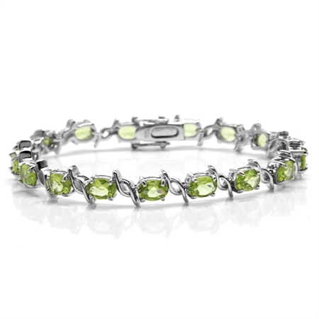 13.43ct. Natural Peridot White Gold Plated 925 Sterling Silver Tennis Bracelet 7.5 Inch.