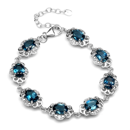 "12ct. Genuine London Blue Topaz White Gold Plated 925 Sterling Silver Filigree 6.5-8"" Adj. Bracelet"